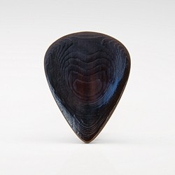 The Nero Jazz series custom water buffalo horn plectrum is a small extremely comfortable pick with a 3d contoured body and a recessed grip area that greatly enhances control and precision.